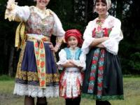 Girls wearing traditional folklore costumes